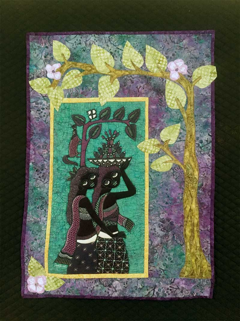 Quilt by Elayne Logan Currie featuring center batik panel by Jaka, inspired by Homegoing by Yaa Gyasi