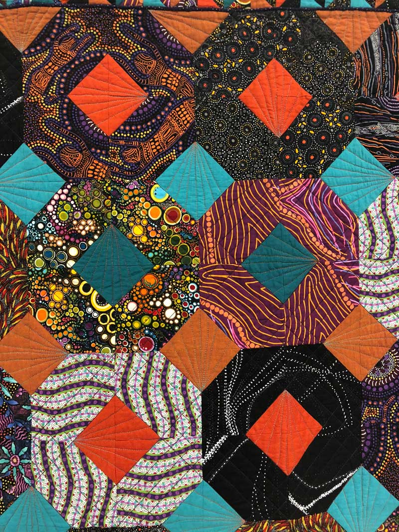 "Detail, ""The Unexpected Visitor Goes Walkabout"" quilt by Jane Butckovitz"