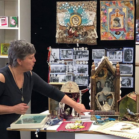 Judy Gula sharing her mixed media art and quilts at the March 2019 Judy's Altered Minds meeting