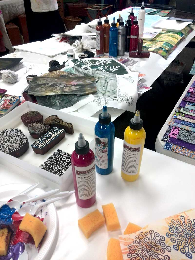 The Artistic Artifacts line of Fluid Textile Paints were used for all surface design demonstrations