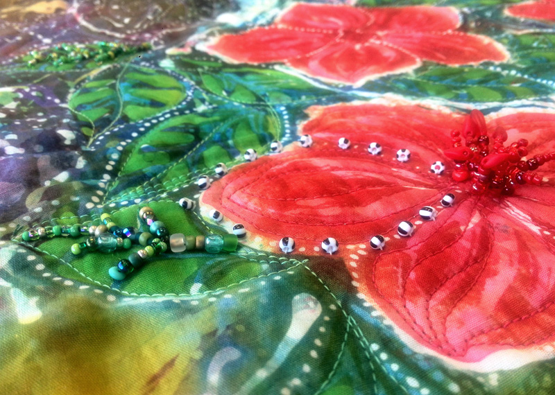 Accenting flower petal edges with beading
