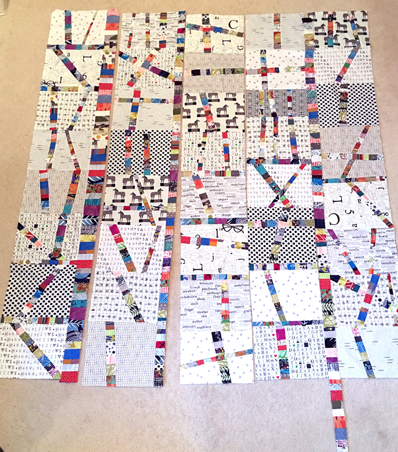 Adding vertical strips to the finished blocks for the final quilt design