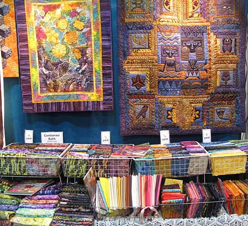 Sample batik quilts and fabric in the Artistic Artifacts booth