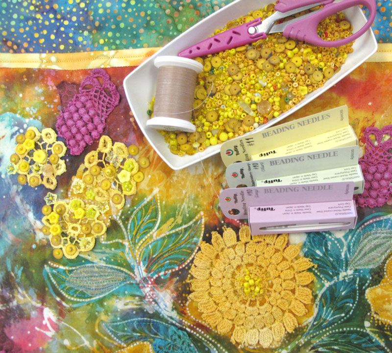 Instructions on how to add beading to your projects is included in Colorful Batik Panel Quilts by Judy Gula