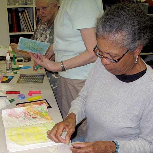 Beverly Hilbert works in her art journal