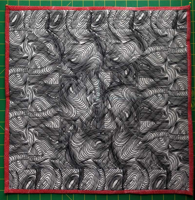 River Dreaming Black fabric pieced into pillow by Christine Vinh, StitchesnQuilts