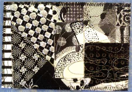 Fabric postcard by Judy Gula, with flattened Pearl Pen