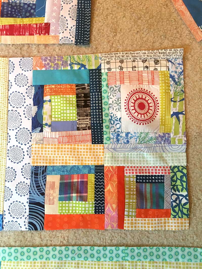 Wonky log cabin block unit for the Block Printed Scrappy Quilt by Judy Gula