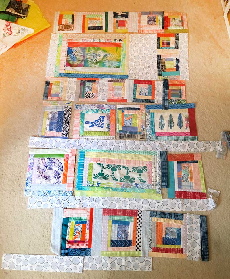 Completing and laying out wonky log cabin block units, Block Printed Scrappy Quilt by Judy Gula