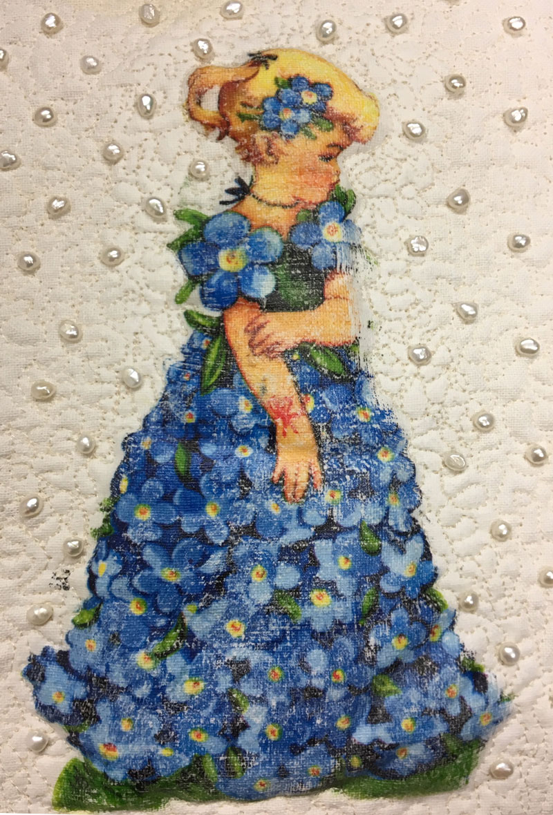 Detail of Bluebell Paper Doll, mixed media art quilt by Judy Gula of Artistic Artifacts