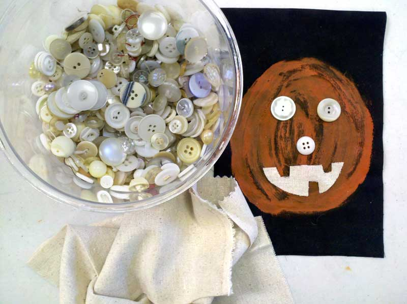 Creating a pumpkin face with vintage buttons
