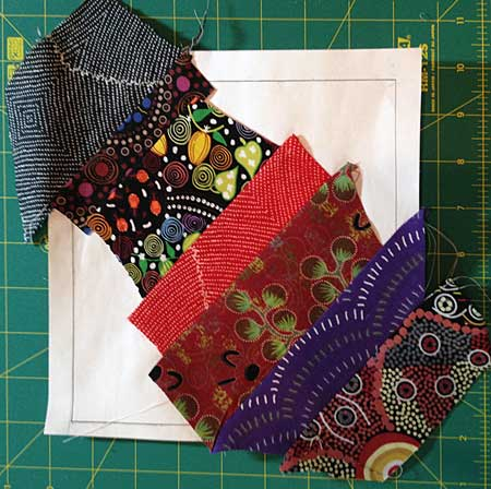 Judy Gula completed string piece center of quarter block template