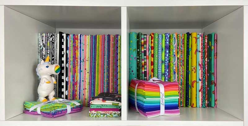 Fabric shelves with touches of whimsy in Cliff Wilson'e sewing space