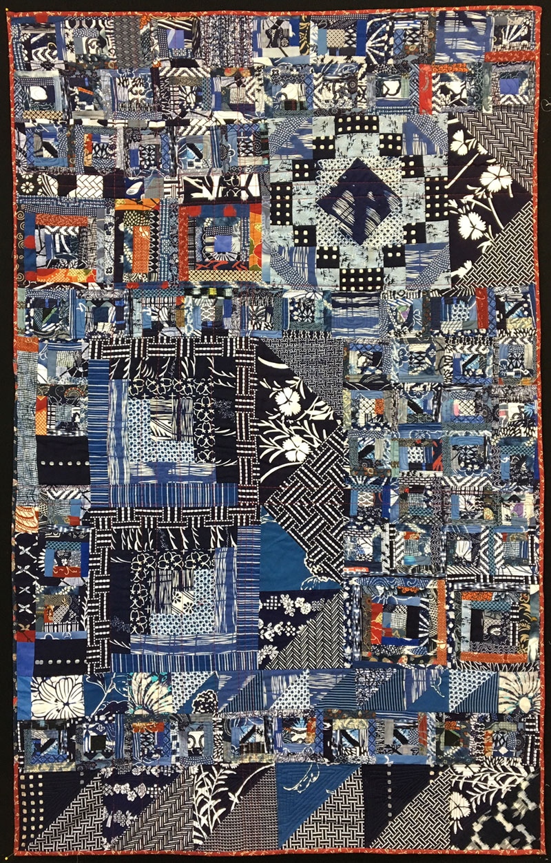 Completed Virginia's quilt by Judy Gula including fabrics and blocks by Virginia Aribe