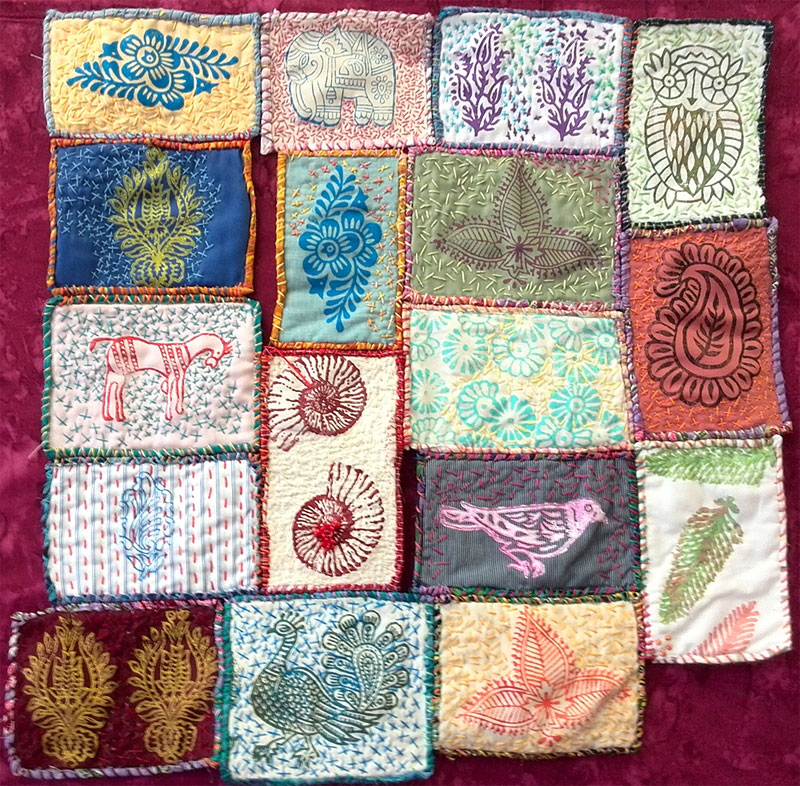 Completed block printed andhand stitched art quilt by Judy Gula