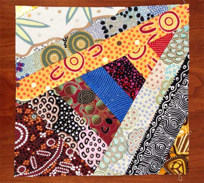 A trimmed quarter block string pieced by Judy Gula