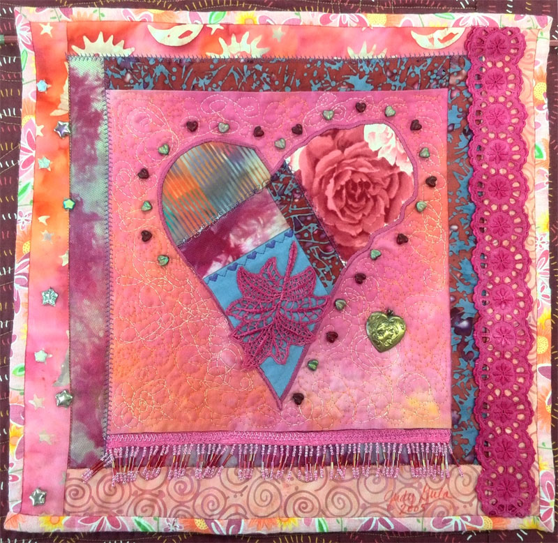 Crazy quilted heart with embellishments: an art quilt by Judy Gula of Artistic Artifacts