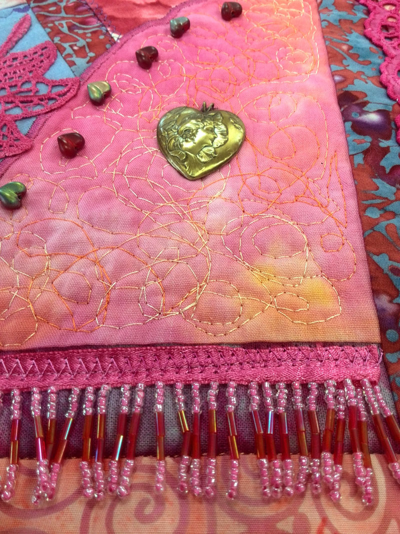 Detail of crazy quilted heart with embellishments by Judy Gula of Artistic Artifacts