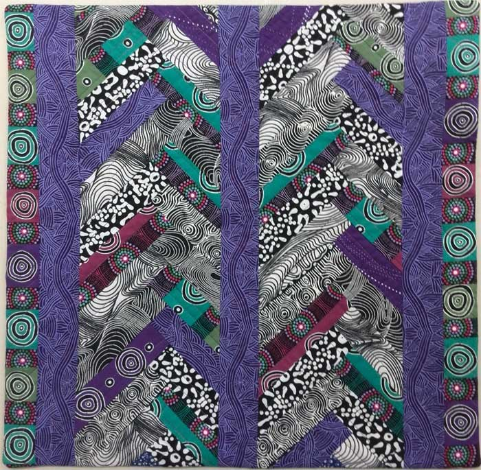 Paper pieced braid quilt by Chris Vinh