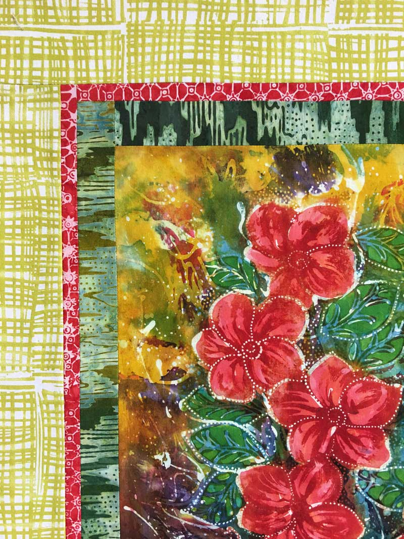 Detail, medium Hari Agung floral panel art quilt ready for quilting and then binding