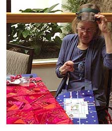 Diane Herbort demonstrating hand stitching