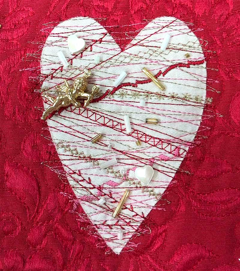 Stitched and embellished heart detail from a quilt by Diane Herbort
