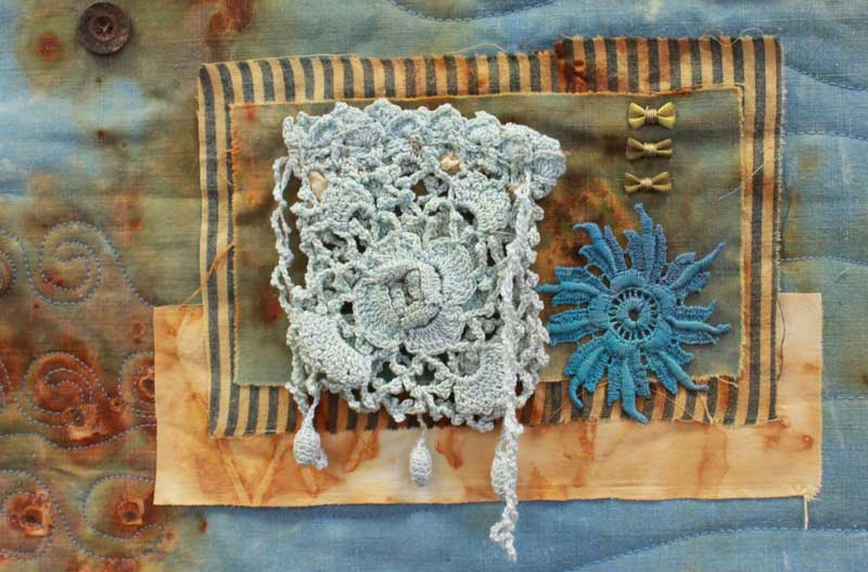Detail of Joy in Things Remembered, a mixed media art quilt by Judy Gula of Artistic Artifacts that will appear in Sacred Threads 2019