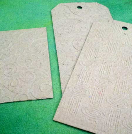 Plain chipboard, die cut into shapes and embossed with texture