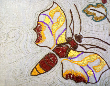 Free motion quilting added to vintage embroidered butterfly