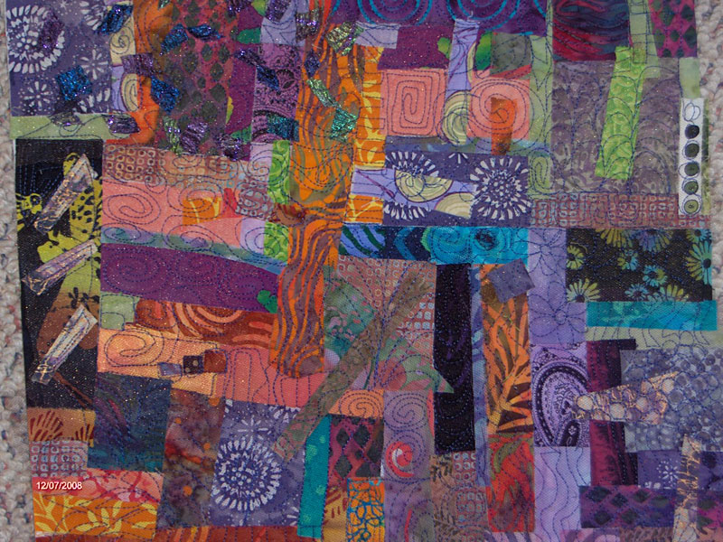 Fused fabric collage after free motion quilting by Judy Gula