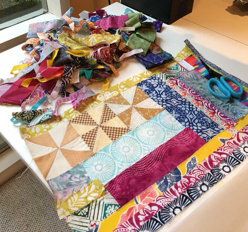 Judy Gula uses a variety of fabric scraps, selvages, orphan blocks and more to create her fabric postcards
