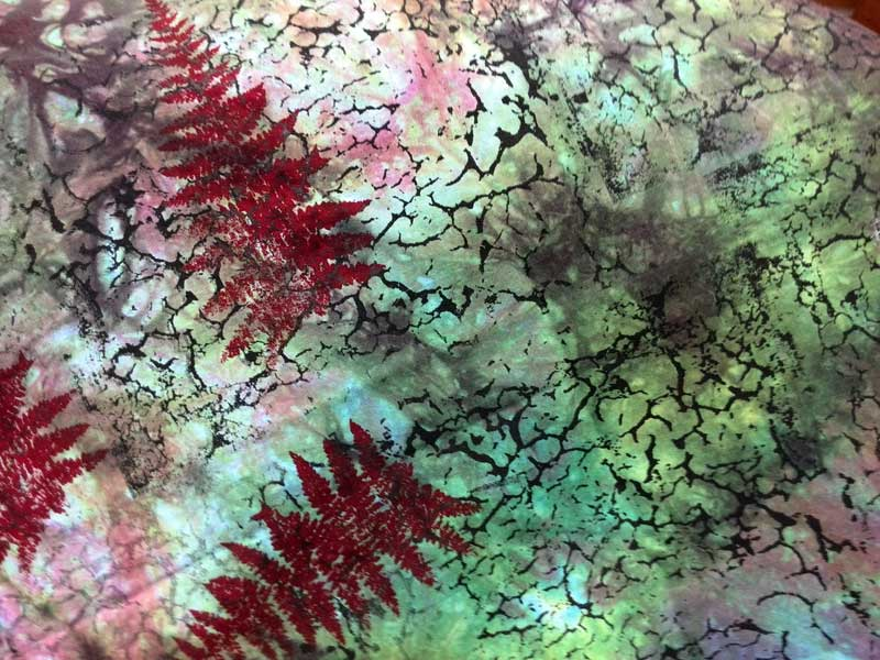 Hand-dyed fabric printed using more than one Thermofax screen