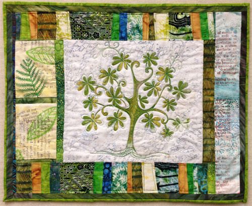 Completed stenciled green tree art quilt by Judy Gula