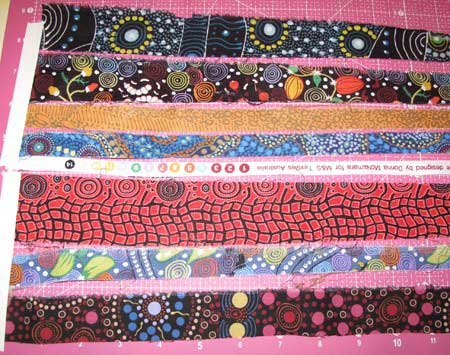 Aborigine designed fabric strips ready for weaving