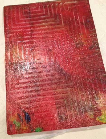 Paint brayered onto a Gelli Arts Gel Printing Plate and impressed with a Rubbing Plate for texture
