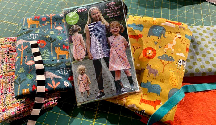 Geo Dress, Tunic & Leggings pattern with the dress and flange fabrics chosen by Nancy McCarthy