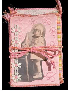Cover, fabric collage photo book by Judy Gula