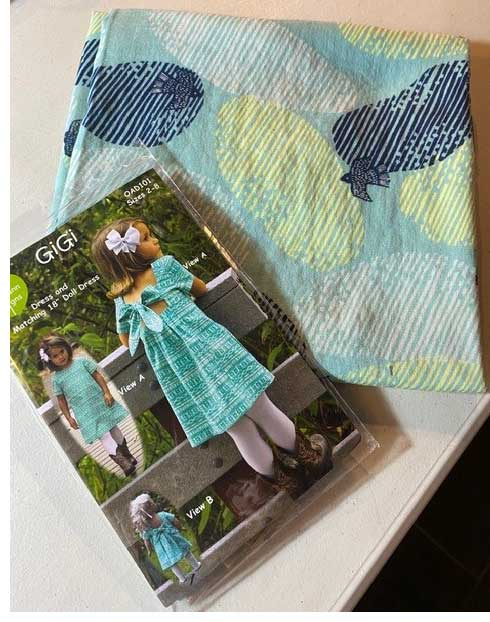 The GiGi Dress and Dolldress by Olive Ann Designs for children sizes 2 thru 8, and double gauze fabric, Kokka Blue Birds
