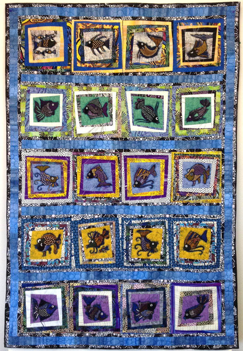 School of Fish by Judy Gula, featured in her book Colorful Batik Panel Quilts