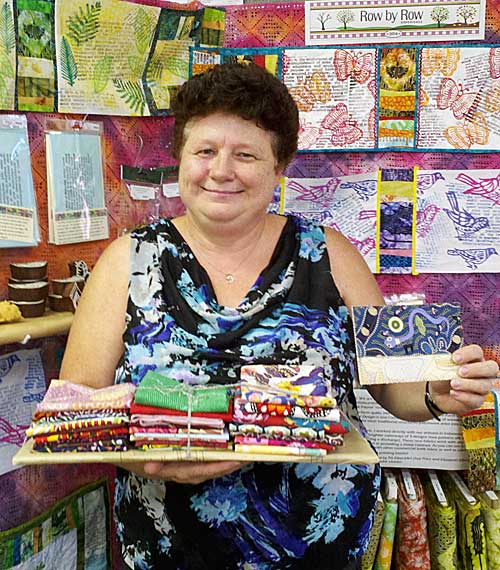 Jana Franklin with her prize of 25 fat quarters and a gift certificate from Artistic Artifacts