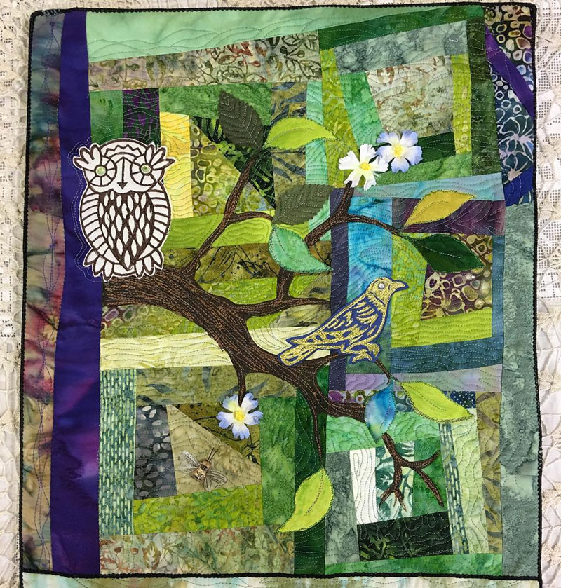 Janet Green improv quilt embellished with wooden block prints