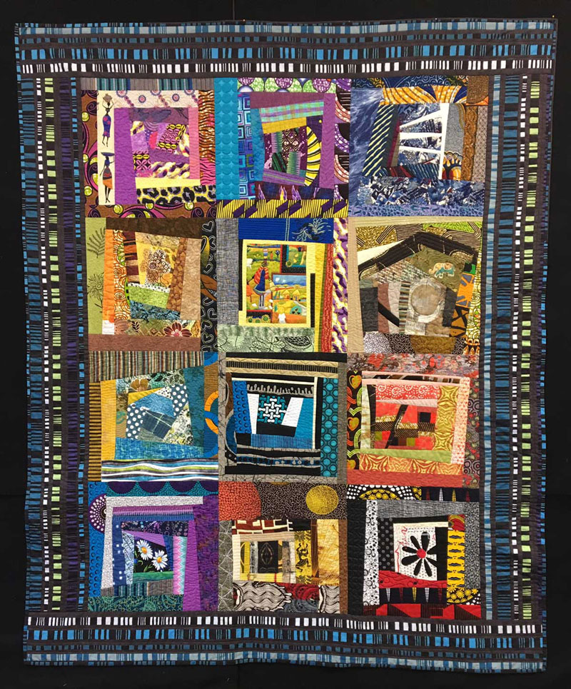 The completed Inside Stories improv quilt by Janet Green