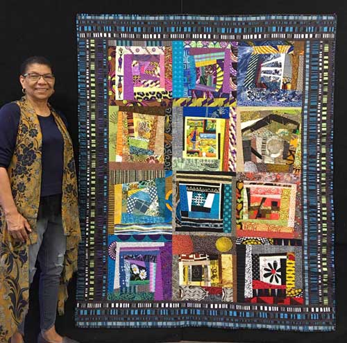 Janet Green with her improv quilt Inside Stories