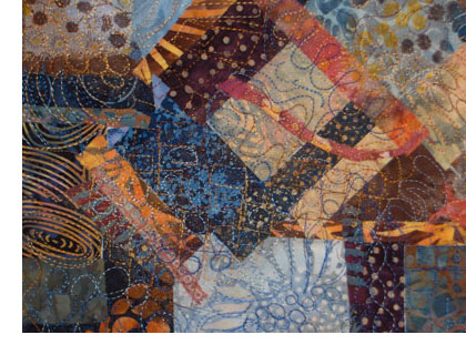Collaged and free motion quilted fabric by Judy Gula