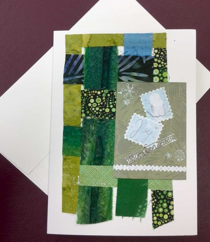 Joy greeting card by Judy Gula using woven fabric strips and Artist Trading Cards