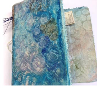 Textured canvas journal made by Judy Gula in a class led by Leighanna Light.