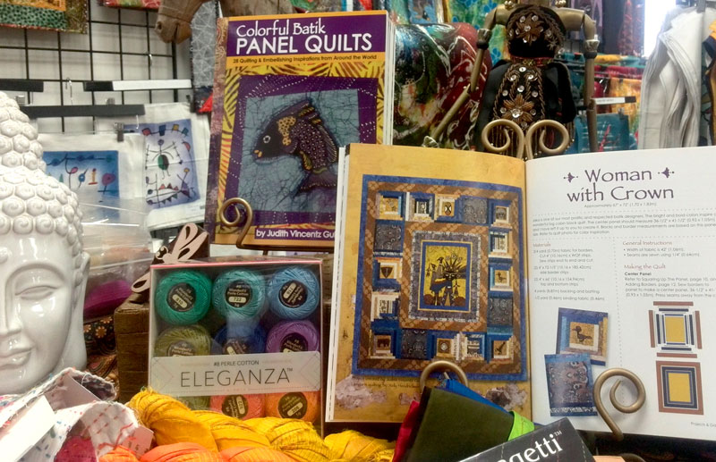Colorful Batik Panel Quilts by Judy Gula on display at Artistic Artifacts