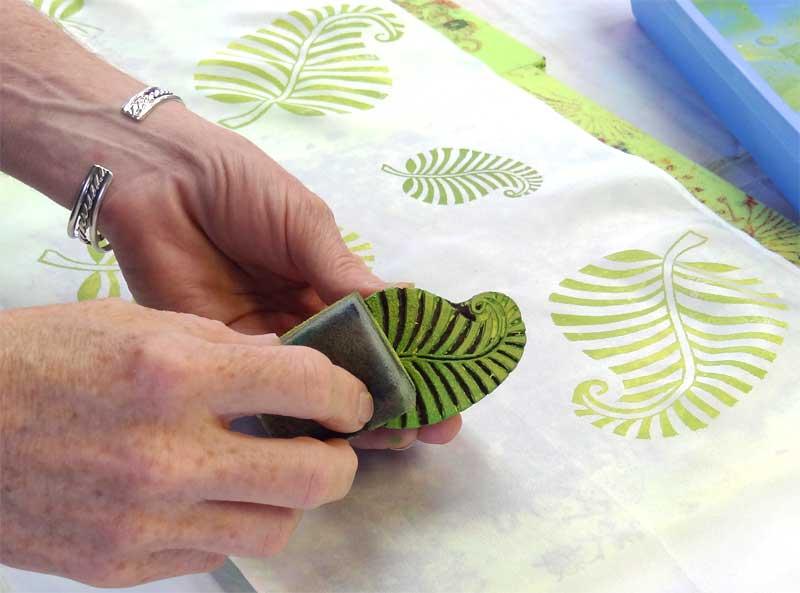 Liz Kettle of Textile Evolution block printing on silk