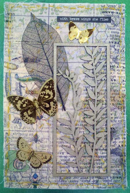 Artwork by Lindy Millman: Tim Holtz fabric, chipboard shape, skeleton leaf, ephemera
