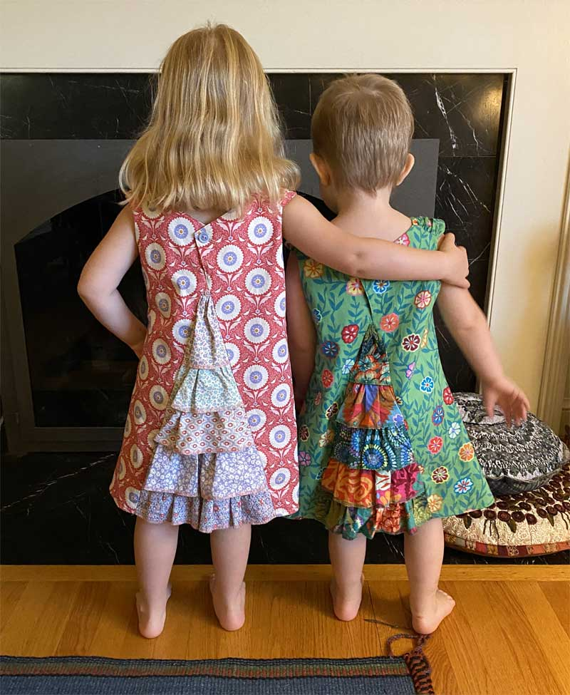 Nancy McCarthy's granddaughters in their Urban Princess dresses, showing the ruffled back